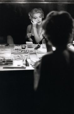 +     Marilyn photographed applying her make up by Sam Shaw in September 1954.