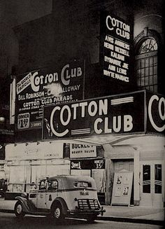 An outside view of the famous Cotton Club in New York City. There's 3 signs about the club, one with the upcoming musicians that will be playing, along with a parked car by the entrance. The Cotton Club seated up to 400 and was known as one of Harlem's classiest jazz clubs. The club was known for presenting some of the best talent like, Louis Armstrong, Ethel Waters, and Bill Robinson. In late 1927, the club booked the young, cocky and highly sophisticated, Duke Ellington.