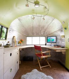 Landscape architect Andreas Stavropoulos chose a light palette with few splashes of color to keep the space in this 1959 Airstream open and contemporary. He stripped the paint to reveal the beautiful riveting and aluminum, honoring the original craftsmanship that went into making this trailer. Cork flooring, track lighting, and custom-designed cabinets and furniture fit the sinuous interior topography. See more at Base Landscape.   - CountryLiving.com