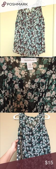 Motherhood maternity sheer floral top sz Medium Very flowy and great for work or anytime. You do need a tank top underneath since it is sheer. It has a little matching string to tie around it. I tried to show the loop in the last picture. Motherhood Maternity Other