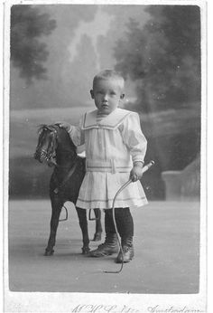 Boy with a toy horse
