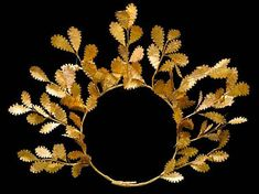 A Hellenistic gold oak wreath, Circa 4th-3rd Century B.C. A delicate wreath made of fine gold oak leaves with acorns, of the type worn by Alexander the Great's father, Philip II of Macedon.