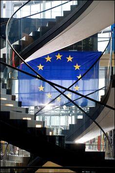 European Union flag in the EP building in Strasbourg. Blue & yellow, 12 European stars.