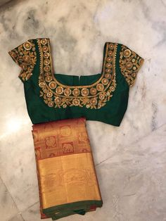 green blouse and gold saree