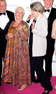 Age is but a number! Glamorous 80-year-old Dames Judi Dench and Maggie Smith joked around on the red carpet at the premiere of their new movie The Second Best Exotic Marigold Hotel in London on Tuesday