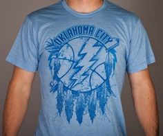 I really want one of these shirts! They come in both orange and blue.
