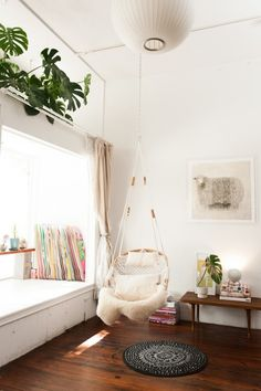 How great is this hanging chair for a reading nook?