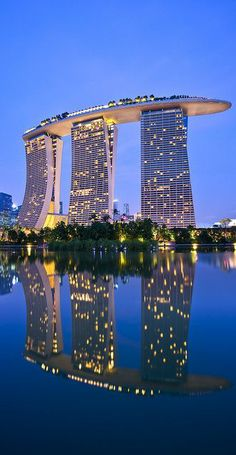 Marina Bay Sands in Singapore. An integrated resort fronting Marina Bay in Singapore. Developed by Las Vegas Sands, it is billed as the world's most expensive standalone casino property at 8 billion dollars, including cost of the prime land. Futuristic Architecture, Amazing Architecture, Singapore Architecture, Architecture Art, Chinese Architecture, Contemporary Architecture, Contemporary Design, Hotel Marina Bay Sands, Beautiful Hotels