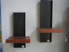 individual wall mounted shelves made from reclaimed I beams and reclaimed wood