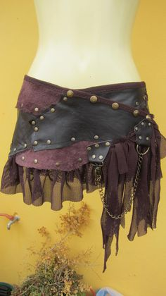 BURNING MAN...leather mini skirt belt/ with pocket,lace and stud detail....4 day EXPRESS 30 dollars
