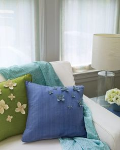 Store-bought cushions spring to life when adorned with pretty, handmade Ultrasuede florets.