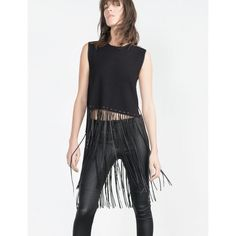 """HP [zara] cropped top w long fringes Such chic top to wear with everything!! We've worn this number with shorts and skater skirts. Or as seen on the cover pic, wear with leather pants! Very versatile; easy chic!  The fringe is faux leather and is stitched around collar and arm holes as well. It is hi-lo, with shorter fringe in front, longer in back. 17"""" front portion, 21"""" fringe. This comes down to the knees for my sister who is 5'6"""" 100% polyester for sweater portion, 100% polyurethane for…"""