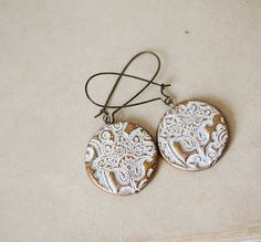 White ornament gold clay earrings
