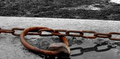 Rusty chains at a harbour