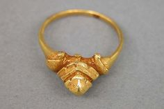Ring with Bezel Composed of Tiered Lozenge Motif   Period: Central Javanese period  Date: Second half of the 8th–second half of the 10th century  Culture: Indonesia (Java)  Medium: Gold  Dimensions: H. 1/8 in. (0.3 cm); Diam. 3/4 in. (1.9 cm)  Classification: Jewelry  Credit Line: The Samuel Eilenberg-Jonathan P. Rosen Collection of Indonesian Gold, Bequest of Samuel Eilenberg and Gift of Jonathan P. Rosen, 1998  Accession Number: 1998.544.304