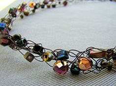 Crocheted wire necklace // Raku beads and Czech Glass // copper, bronze, blue, gold // by ElephantBeads