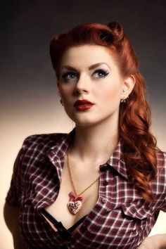 Gingerhead red hair shot. She looks up in her red square shirt with cleavage and necklas.