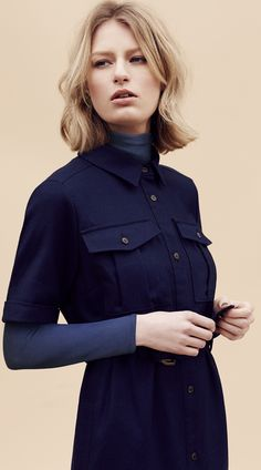 Look mature, sophisicated & have a good sense of fashion with this Pure New Wool Belted Shirt Dress. Add a long sleeve top underneath for when the weather gets colder.