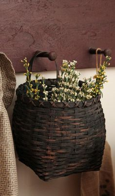 Black reproduction basket with flowers                                                                                                                                                     More