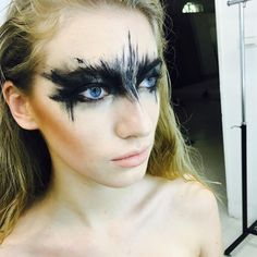 Creative black eye makeup for Halloween.