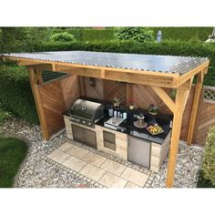 Self-built, covered outdoor stone kitchen with Napoleon built-in barbecue and kitchen.Self-built, covered outdoor stone kitchen with Napoleon built-in barbecue and hob // outdoor kitchen build ideas // selfmade outdoor kitchen out of st. Build Outdoor Kitchen, Outdoor Kitchen Countertops, Backyard Kitchen, Outdoor Kitchen Design, Backyard Patio, Diy Patio, Backyard Barbeque, Kitchen Cabinets, Kitchen Appliances