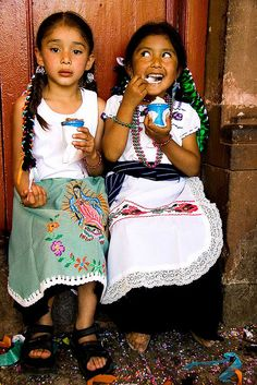 Niñas would love to take a picture of my girls like this just for fun. with braids and aprons. love it! [ MexicanConnexionforTile.com ] #culture #Talavera #Mexican