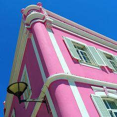 pink building by mark e dyer, via Flickr