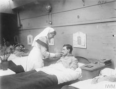 Feb 14 1918 A nurse attends to a soldier in a ward on a hospital barge near Aire