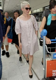 Chic: Michelle Williams looked effortlessly stylish in a striped smock dress as she arrive...