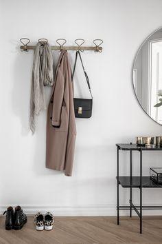 my scandinavian home: brass coat rack in a Swedish hallway.