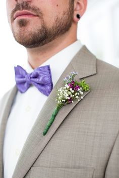 Purple bow tie with simple rustic boutonnière