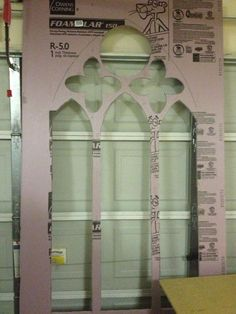 Turn your house into a creepy castle with cathedral window silhouettes made of construction foam.