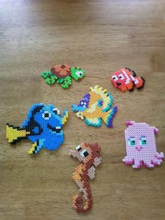 Finding Nemo characters perler beads by Kaitlynn G. Perler Bead Designs, Hama Beads Design, Diy Perler Beads, Perler Bead Art, Pearler Beads, Melty Bead Patterns, Pearler Bead Patterns, Perler Patterns, Beading Patterns