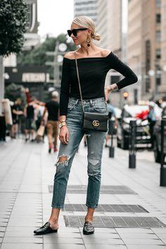 e63d50b64d1 Blonde Woman Wearing Jcrew black off the shoulder top Levis Denim Ripped  Jeans Gucci Marmont Handbag