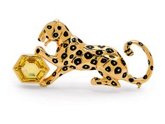 A Yellow Sapphire, Enamel and Gold Panther Brooch, Cartier   The playful panther decorated with black enamel spot motifs and a hexagonal yellow sapphire weighing 5.80 carats, mounted in 18 gold, signed Cartier and numbered 674930, French assay marks