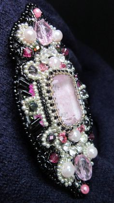 brooch in pink. Bezel work vintage glass cabochon and antique bugle beads. having fun with seeds!