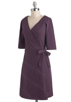 It's the weekend, finally! Lose the slacks and heels, and slip into this violet, fair trade wrap dress, then hop in the car. As you start your drive, it occurs to you that the road ahead of you echos the one embroidered in violet purple and pale blue on the skirt of this side-tied frock! Under a slouchy taupe sweater, and with bright tights and flat boots, this organic cotton dress is the eco-friendly answer to your casual-cute, commitment-free weekend wardrobe!