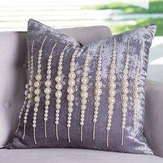 """Every girl should have at least one strand of pearls! And the """"strands of pearls"""" pillow gives a gal more than her share. Clever, linear pearl strands manage to look both modern and traditional when detailing silver leaf luminescent -brushed velvet."""