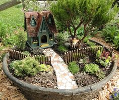 With plants and a pathway kit from http://TwoGreenThumbs.com, I now have my own miniature garden. I just have to wait for the mosses to fill in. - DIY Fairy Gardens
