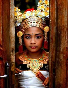 Legong dancer, Bali, Indonesia - Balinese dances incorporate eye and facial expressions invoking hyang spirits that is believed to possess the dancers in trance state during the performance.