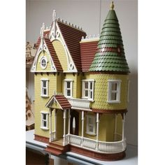 Ceiling height is 9 The house comes with milled exterior walls, round turret with precut to fit shingles, 8 working windows, 1 working main door, 2 working interior doors. Dollhouse Kits, Main Door, Glitter Houses, Ceiling Height, Doll Houses, Scale, Ships, Miniatures, Victorian