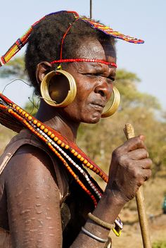 Africa    A Pokot woman    © Rita Willaert.  These necklaces are made out of woven from natural materials such as reeds, strands from the Doum palm, or the stems of the asparagus tree or sedge grass.  This is decorated with beads, buttons, etc a mixture of animal fat and red ochre.