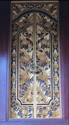 Pretty gold and purple door in Bali.