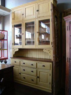 Free standing cupboard with beadboard, bin pulls, and glass doors