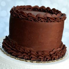 Our triple chocolate cake -- rich chocolate caked layered with decadent chocolate mousse and covered with a sinful chocolate ganache frosting. Decadent Chocolate, Chocolate Cake, Chocolate Ganache Frosting, Mousse, Delish, Wedding Cakes, Bakery, Beverages, Treats