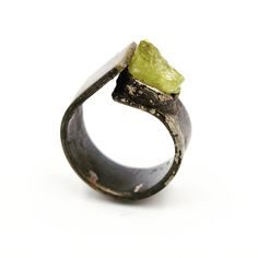 Art Jewelry:  Distressed Sterling silver ring, set with raw Peridot