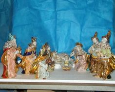 "SACRED PIECE: 10-PIECE NATIVITY SCENE: 15"" (38cm) Display area.    This Piece is the work of Apolito Carmine Giuseppe who apprenticed under Eugenio Pattarino after attending the School of Arts in Sesto Fiorentino specializing in Artistic Ceramics. All pieces produced are worked by hand and hand painted with brilliant enamels and pure gold."