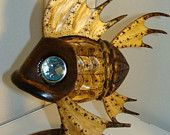 Wooden fish has blue crystal eyes with silver outline.