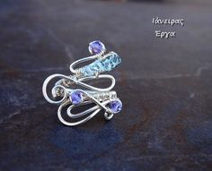 Silver plated wire wrapped adjustable ring in purple and by Ianira