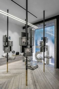 """""""Tree"""" display cases and smoke in the shop window. Ileana Makri Store by Kois Associated Architects"""